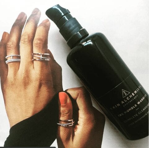 woman's hands with silver jewellery showing off Skin Alchemist lotion