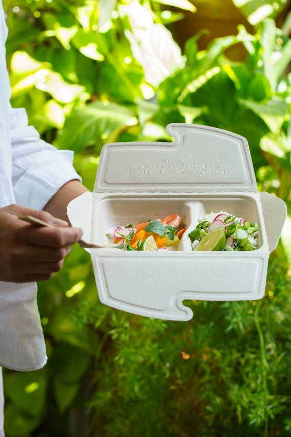 Man holding a Simply Stem Sabert 2 part Meal Box To Go with thai food